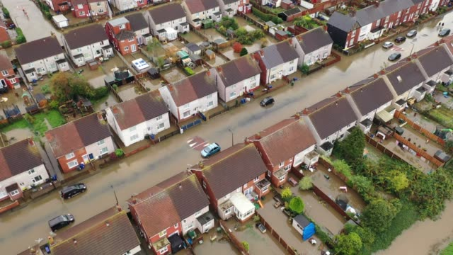 an aerial view of houses and cars submerged under water following severe flooding on november 08 2019 in doncaster united kingdom parts of northern... - yorkshire england stock videos & royalty-free footage