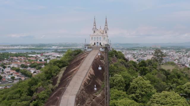 an aerial view of igreja de nossa senhora da penha. basilica of the archidiocesan marian shrine of our lady of penha. rio de janeiro. brazil. - famous place stock-videos und b-roll-filmmaterial