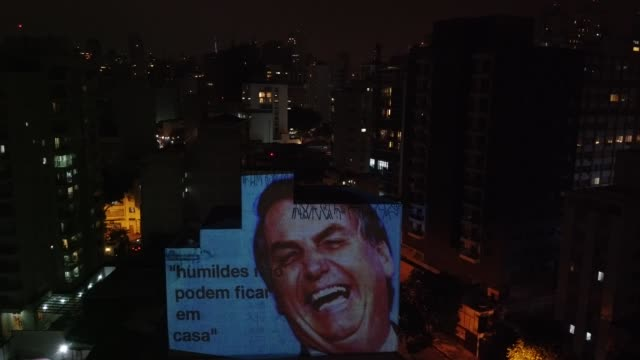 an aerial view of images of president of brazil projected on a building's wall to protest against his government during a pans protest on april 16,... - brazil stock videos & royalty-free footage