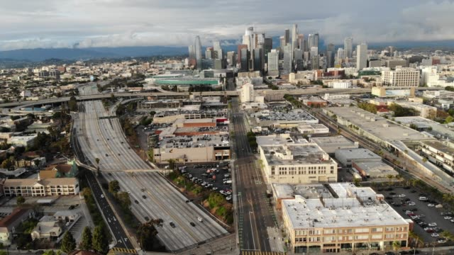 an aerial view of light traffic during what would normally be the evening rush hour on south figueroa street and the 110 freeway amid the coronavirus... - city of los angeles stock videos & royalty-free footage
