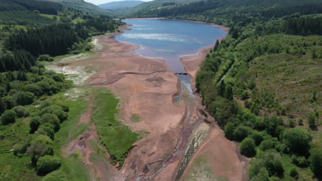 an aerial view of low water levels in the llwyn-on reservoir in taf fawr valley on may 29, 2020 in merthyr tydfil, united kingdom. the met office... - valley stock videos & royalty-free footage
