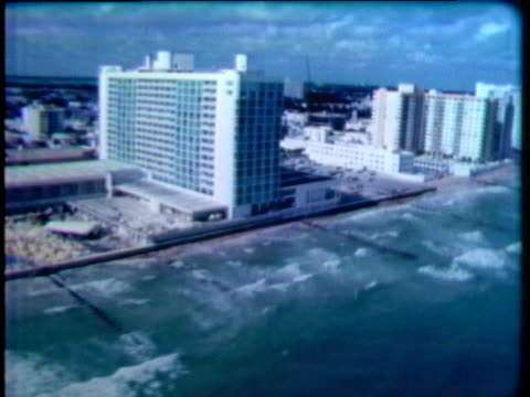 an aerial view of miami beach depicts hotels that were built right up to the sea. - tourist resort stock videos & royalty-free footage