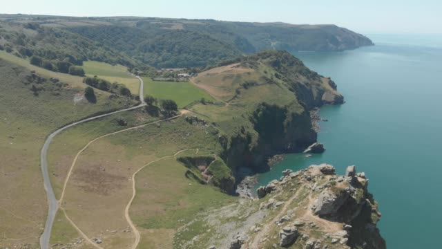 an aerial view of natural rock formations along the coast in valley of rocks, exmoor national park, devon, england. - geology stock videos & royalty-free footage