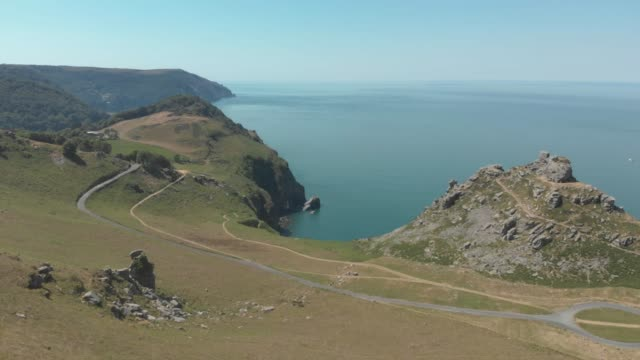 an aerial view of natural rock formations along the coast in valley of rocks, exmoor national park, devon, england. - exmoor national park stock videos & royalty-free footage