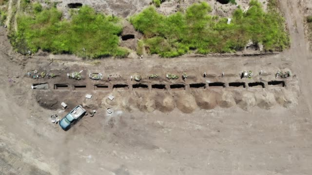an aerial view of newly dug graves at tijuana municipal cemetery 13 amid the covid-19 pandemic on may 11, 2020 in tijuana, mexico. a cemetery... - cemetery stock videos & royalty-free footage