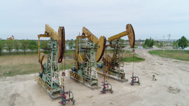 vídeos de stock e filmes b-roll de an aerial view of oli pumping units at daqing oil field on may 20 2017 in daqing china daqing is one of the most important oil city in china - bomba petrolífera