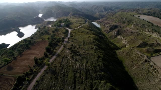an aerial view of plowed fields near choi dam from drone - pakistan video stock e b–roll