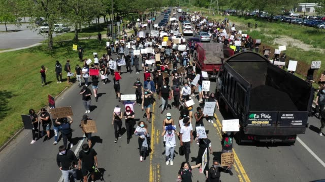 an aerial view of protesters gather at brentwood state park to protest the recent death of george floyd on may 30 2020 in brentwood new york... - george floyd stock videos & royalty-free footage