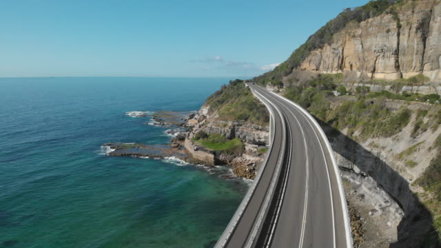 vídeos y material grabado en eventos de stock de an aerial view of sea cliff bridge in new south wales australia - vía