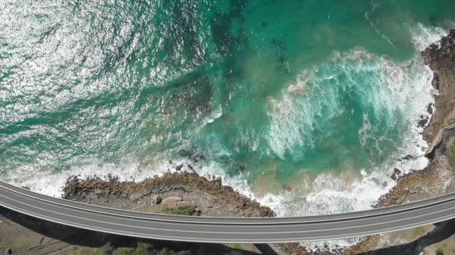 an aerial view of sea cliff bridge in new south wales australia - cantilever bridge stock videos & royalty-free footage