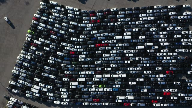 an aerial view of stationed rental cars parked at dodger stadium amid the coronavirus pandemic on may 20, 2020 in los angeles, california. with major... - car park stock videos & royalty-free footage