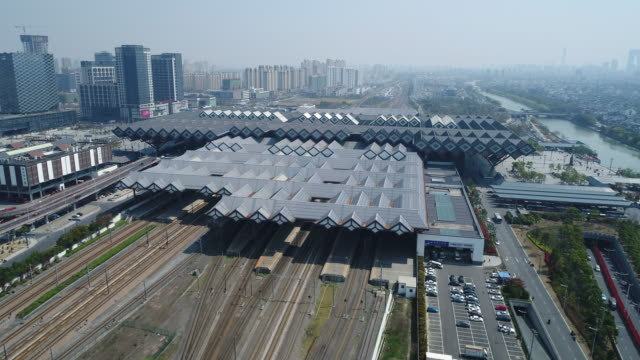 an aerial view of suzhou train station on march 27, 2017 in suzhou, china. - 線路のポイント点の映像素材/bロール