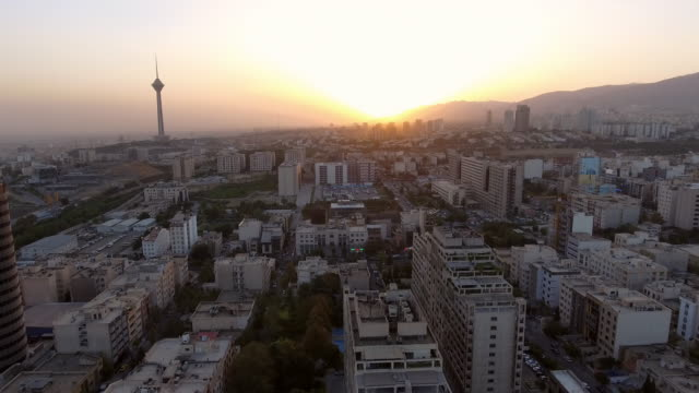an aerial view of tehran, iran at sunrise. - david ewing stock videos & royalty-free footage