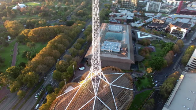 vídeos de stock e filmes b-roll de an aerial view of the arts centre melbourne at sunrise. - david ewing
