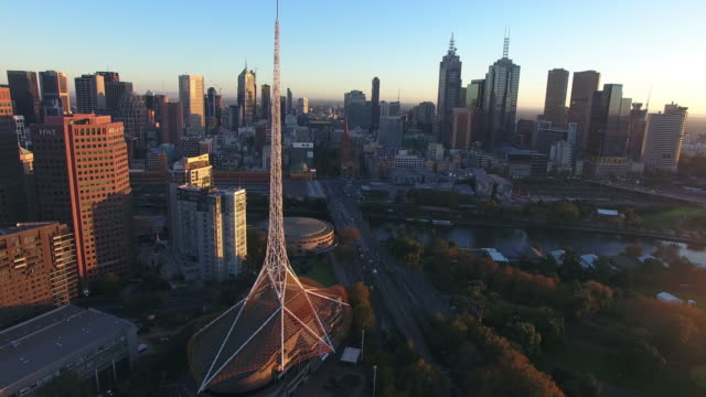 an aerial view of the arts centre melbourne at sunrise. - david ewing stock videos & royalty-free footage