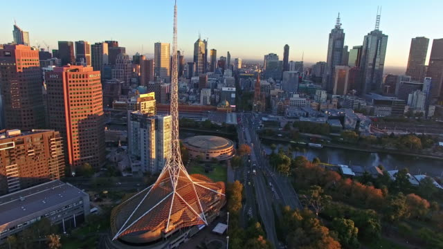 An aerial view of the Arts Centre Melbourne at sunrise.
