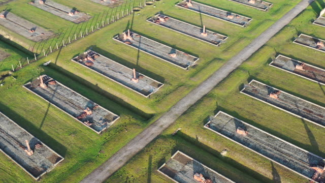 an aerial view of the auschwitz iibirkenau extermination camp on december 19 2019 in oswiecim poland ceremonies marking the 75th anniversary of the... - concentration camp stock videos & royalty-free footage