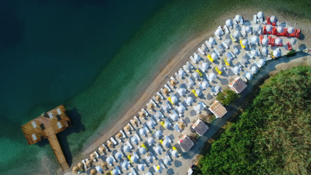 an aerial view of the beach in summer - parasol stock videos & royalty-free footage