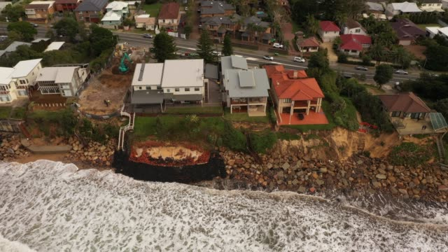 an aerial view of the coastal erosion to local homes in the suburb of wamberal on july 17, 2020 in central coast, australia. beachfront homes along... - eroded stock videos & royalty-free footage