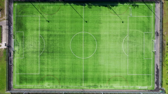 vídeos y material grabado en eventos de stock de an aerial view of the empty maritime recreation ground pitch during the coronavirus lockdown period on may 6 2020 in pontypridd wales the country... - período deportivo