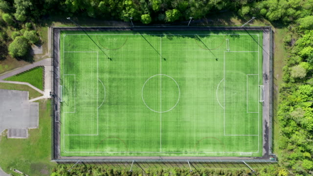 an aerial view of the empty maritime recreation ground pitch during the coronavirus lockdown period on may 6, 2020 in pontypridd, wales. the country... - football pitch stock videos & royalty-free footage