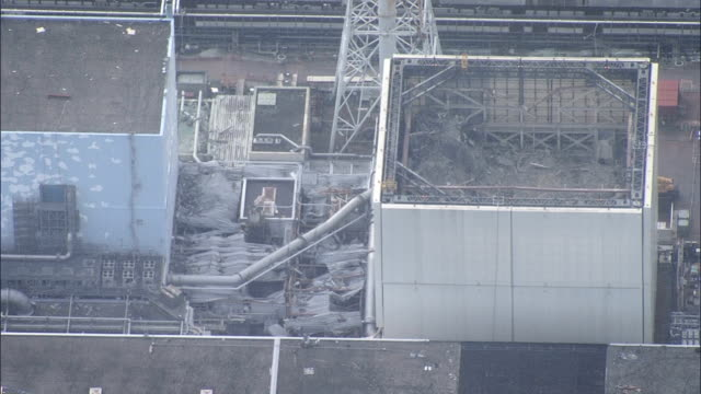 an aerial view of the fukushima no. 1 nuclear power plant, crippled by the great east japan earthquake and tsunami five years ago. video was shot on... - atomkraftwerk stock-videos und b-roll-filmmaterial