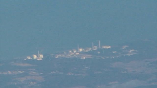 an aerial view of the fukushima no. 1 nuclear power plant shot on april 4, 2011. - atomkraftwerk stock-videos und b-roll-filmmaterial