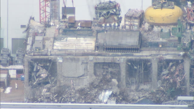 an aerial view of the fukushima no. 1 nuclear power plant shot on july 23, 2012. - nuclear power station stock videos & royalty-free footage