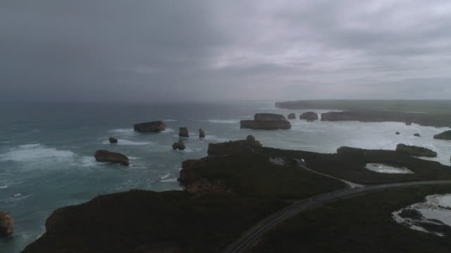 an aerial view of the great ocean road and bay of islands. victoria. australia. - great ocean road stock videos & royalty-free footage