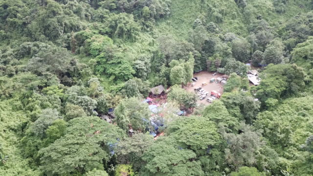 an aerial view of the hills above the cave network where boys among a group of 13 trapped in a flooded cave in khun nam nang non forest park in the... - cave stock videos & royalty-free footage