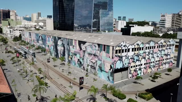 an aerial view of the huge mural painted by eduardo kobra, which forms an important part of the olympic boulevard on march 26, 2020 in rio de... - rio de janeiro stock videos & royalty-free footage