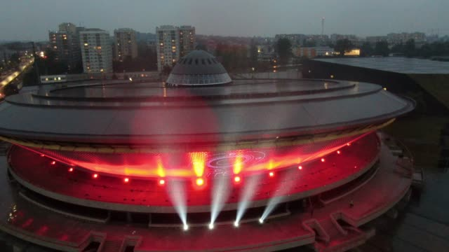 an aerial view of the iconic communist-era arena complex named spodek lit up in red lights during a global action to raise awareness of the live... - music stock videos & royalty-free footage