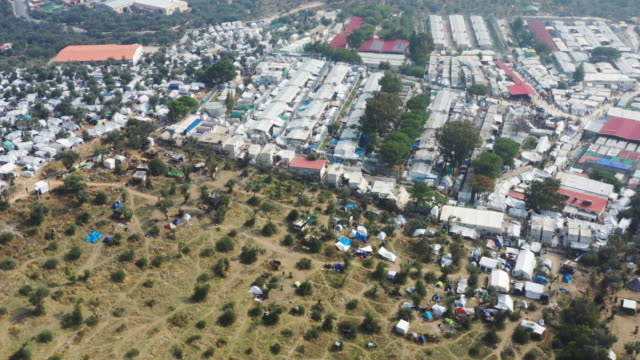 an aerial view of the moria migrant camp which was built for 3000 people but now contains over 13000 on october 09 2019 in mytilene greece... - flüchtling stock-videos und b-roll-filmmaterial