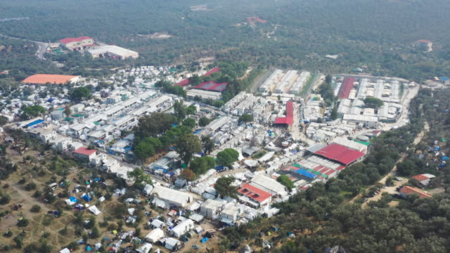 an aerial view of the moria migrant camp which was built for 3,000 people but now contains over 13,000 on october 09, 2019 in mytilene, greece.... - flykting bildbanksvideor och videomaterial från bakom kulisserna