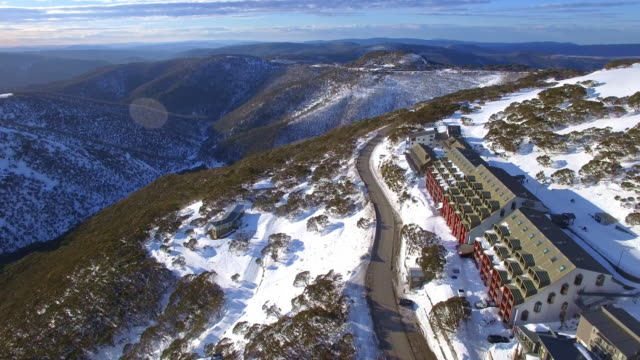 an aerial view of the mount hotham ski resort in the victorian alps, great dividing range. - victoria australia stock videos & royalty-free footage