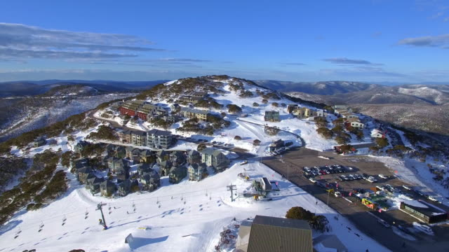 an aerial view of the mount hotham ski resort in the victorian alps, great dividing range. - david ewing stock-videos und b-roll-filmmaterial