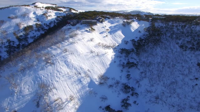 an aerial view of the mount hotham ski resort in the victorian alps, great dividing range. - snowcapped mountain stock videos and b-roll footage