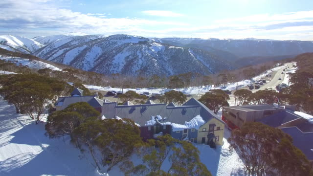 an aerial view of the mount hotham ski resort in the victorian alps, great dividing range. - winter sport stock videos and b-roll footage
