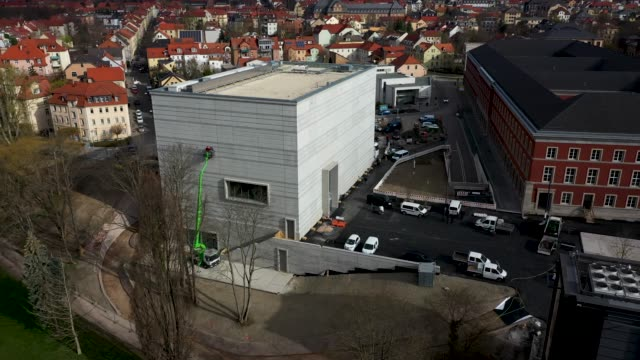 an aerial view of the new bauhausmuseum weimar on april 04 2019 in weimar germany the museum is devoted to the bauhaus and shows examples of bauhaus... - weimar stock videos & royalty-free footage