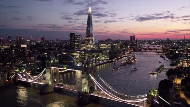 july 2019: an aerial view of the night lights of london as the sun goes down over tower bridge and the shard - bright stock videos & royalty-free footage