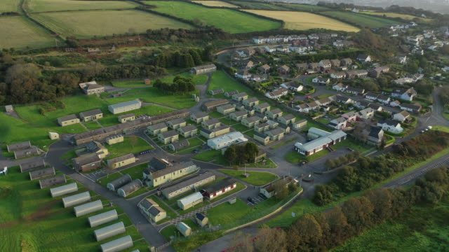 an aerial view of the penally training camp and the neighbouring village of penally on september 21 2020 in penally wales penally army training camp... - pembrokeshire stock videos & royalty-free footage