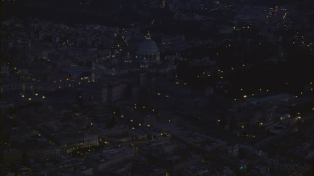 vidéos et rushes de an aerial view of the st peters basilica with the cityscape of vatican city. - rome italy