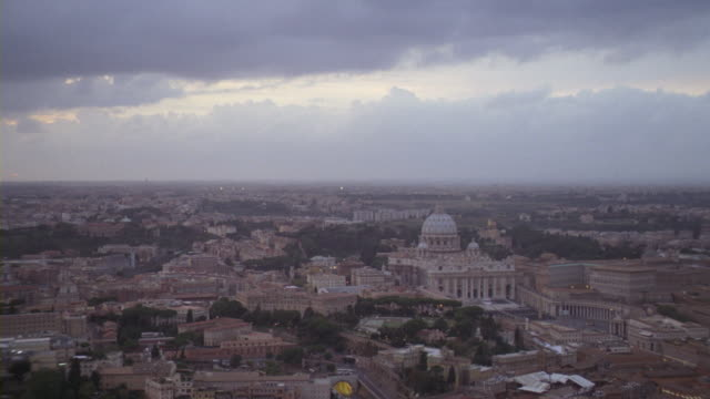 An aerial view of the St Peters Basilica with the cityscape of Vatican City.