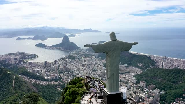 an aerial view of the statue of christ the redeemer during the opening ceremony of the festivities in honor of the 90th anniversary of the statue on... - latin america stock videos & royalty-free footage