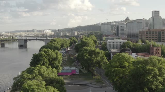 an aerial view of the waterfront park with the steel bridge in the background. portland. oregon. usa. - tom mccall waterfront park stock videos & royalty-free footage