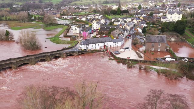 an aerial view of the welsh village of crickhowell which has been cut off as the river usk bursts its banks at crickhowell bridge near the bridge end... - crickhowell stock videos & royalty-free footage