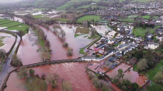 an aerial view of the welsh village of crickhowell which has been cut off as the river usk bursts its banks at crickhowell bridge near the bridge end... - typisch walisisch stock-videos und b-roll-filmmaterial