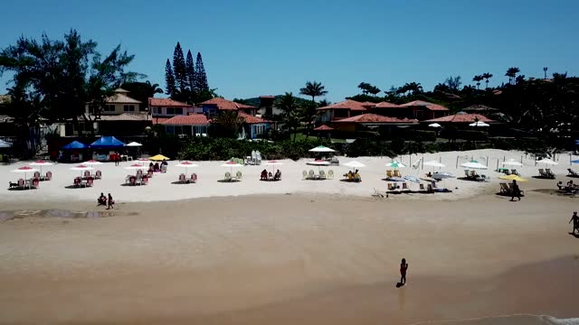 an aerial view of tourists enjoying the weather at geriba beach on december 19, 2020 in buzios, brazil. a tourist ban that was set in place due to... - tourism stock videos & royalty-free footage