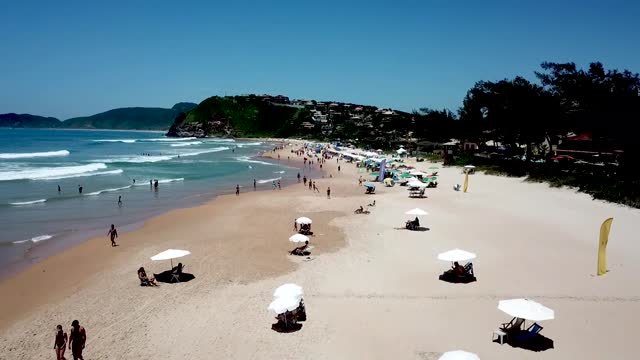 stockvideo's en b-roll-footage met an aerial view of tourists enjoying the weather at geriba beach on december 19, 2020 in buzios, brazil. a tourist ban that was set in place due to... - tourism