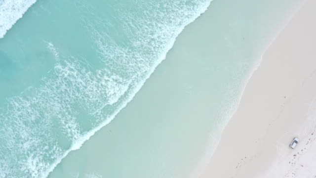 an aerial view of waves crashing on beach in esperance, western australia. - turquoise colored stock videos & royalty-free footage